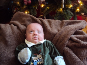 The best Christmas picture we got of this little wiggle worm...