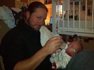 Daddy is a pro at giving me my bottle!