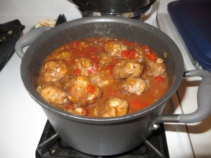 coat meatballs with sauce