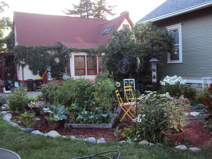 Here's a shot from last summer's garden. I use Square Foot Gardening, so I fit a lot in a small space.