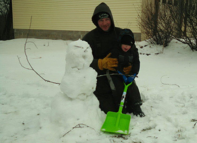 "Jax wasn't really into building the snowman. He would have much rather used his ""shuble"" to knock its' head off!"