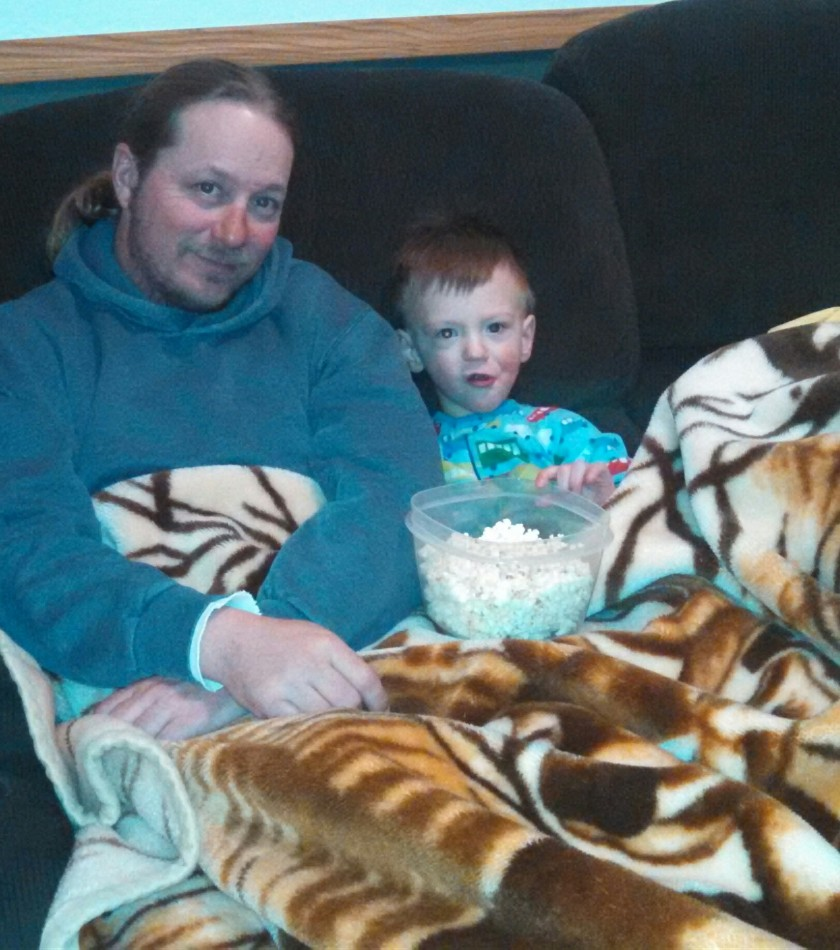Dad and Jax enjoying a movie and popcorn earlier this week.